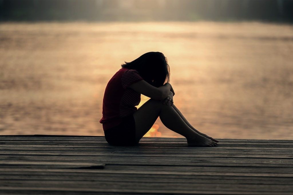a sad woman thinking about how to move on after a difficult breakup